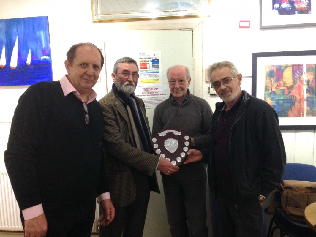 Bob Gregory (Samuel Gawith) has just presented the Northern Briars/Samuel Gawith Inter Club Challenge Trophy to the Canal Smoke Off  winning team, Ian Walker,Steven Hersey and John Green.