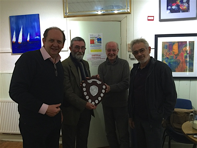 Steve Hersey receiving the Northern Briars/Samuel Gawith Inter Club Challenge Shield (Canal Towpath Smokeoff) from Bob Gregory (Samuel Gawith) with the other members of the winning team Ian Walker and John Green.